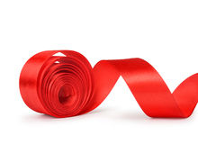 the unwound roll of red ribbon Stock Image