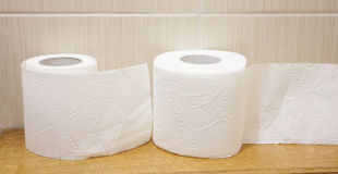 The unwound rolls of white toilet paper Stock Images