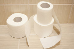 The unwound rolls of white toilet paper Stock Photography