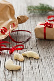 Unwrap Christmas presents and eating Christmas cookies stock photos