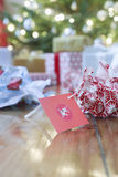 Unwrapped Gift Paper And Tag On Hardwood Floor Royalty Free Stock Photos