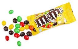 Unwrapped M&M`s milk chocolate candies Stock Photo