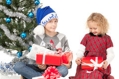 Unwrapping Xmas gifts Royalty Free Stock Image