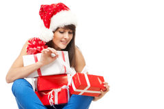 Unwrapping Xmas gifts Royalty Free Stock Photos