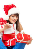Unwrapping Xmas gifts Stock Photo