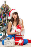 Unwrapping Xmas gifts Stock Image