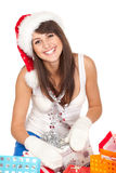 Unwrapping Xmas gifts Royalty Free Stock Photography