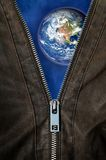 Unzip the space. Detail of an opened zipper revealing a earth in the space Royalty Free Stock Photos