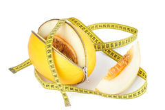 Unzipped melon and measuring tape Royalty Free Stock Images
