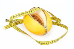 Unzipped melon and measuring tape Stock Photo
