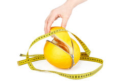 Unzipped melon and measuring tape Royalty Free Stock Photography