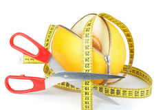 Unzipped melon and measuring tape Royalty Free Stock Photo