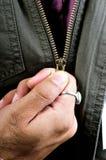 unzipping куртки Стоковая Фотография