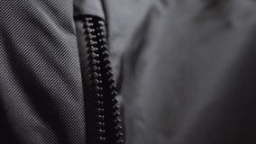 Unzipping Zip of a high quality travel backpack. Side view. Close up, 4k stock footage