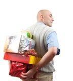 Uomini adulti con i regali di natale sopra bianco Immagini Stock