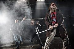 Uomini aggressivi con le armi Fotografia Stock Libera da Diritti