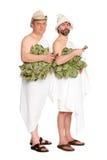 Uomini allegri con i ramoscelli della quercia in costumi da bagno Immagini Stock