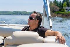 Uomini 60 anni che si rilassano su una barca Fotografia Stock Libera da Diritti