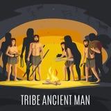 Uomini antichi che fanno fuoco in caverna Immagine Stock
