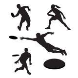 Uomini che giocano ultimo frisbee 4 siluette Fotografia Stock