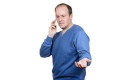 Uomini che parlano sul telefono Fotografia Stock