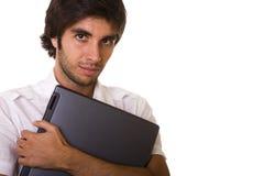 Uomini che tengono un computer portatile Immagini Stock