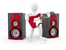 Uomini con la chitarra e l'altoparlante Fotografia Stock Libera da Diritti