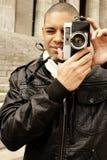 Uomini con la macchina fotografica Fotografia Stock