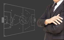Uomini d'affari che progettano i concetti di calcio Immagini Stock