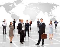 Uomini d'affari che si levano in piedi nella parte anteriore Fotografia Stock Libera da Diritti