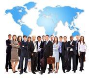 Uomini d'affari che si levano in piedi nella parte anteriore Immagini Stock