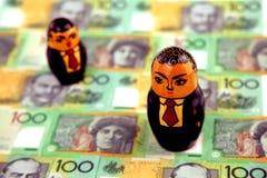 Uomini d'affari con soldi australiani Fotografia Stock Libera da Diritti