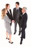 Uomini d'affari e chiacchierata delle donne di affari Fotografia Stock Libera da Diritti