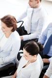 Uomini d'affari e donne di affari sulla conferenza Fotografia Stock Libera da Diritti