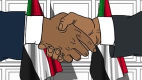 Uomini d'affari o politici che stringono le mani contro le bandiere del Sudan Animazione relativa del fumetto di cooperazione o d illustrazione di stock