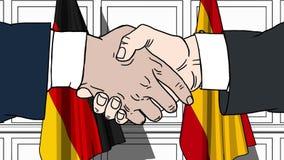 Uomini d'affari o politici che stringono le mani contro le bandiere della Germania e della Spagna Riunione o fumetto relativo di  royalty illustrazione gratis