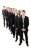 Uomini d'affari su una riga Immagine Stock Libera da Diritti
