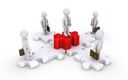 Uomini d'affari sui pezzi collegati di puzzle e capo Fotografie Stock