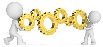 uomini 3D che manipolano gli ingranaggi dell'oro Immagine Stock Libera da Diritti