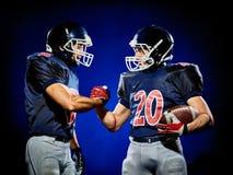 Uomini dei giocatori di football americano isolati fotografie stock