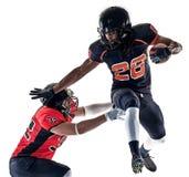 Uomini dei giocatori di football americano isolati fotografie stock libere da diritti