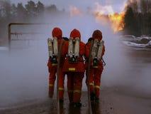 Uomini del fuoco nell'azione Immagine Stock