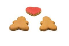 Uomini di pan di zenzero e un cuore Immagine Stock