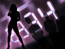 Uomini e donne alla notte Immagini Stock