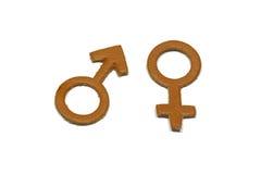 Uomini e femmina con il simbolo astratto di amore fatto di cuoio isolato su fondo bianco Fotografia Stock