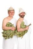 Uomini felici con i ramoscelli della quercia in costumi da bagno Fotografia Stock Libera da Diritti