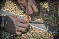 Uomini masai che fanno fuoco Immagini Stock Libere da Diritti
