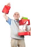 Uomini piacevoli con i sacchetti di acquisto colorati Immagini Stock