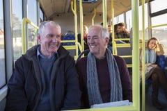 Uomini senior sul bus Fotografia Stock