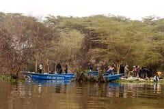 Uomini su una barca Fotografia Stock